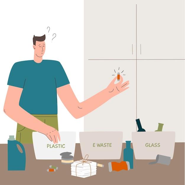 젊은 남자는 재활용을 위해 집에서 쓰레기를 분류하고 플라스틱 유리 전자 제품을 제로 폐기물로 분리합니다