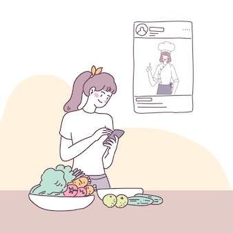 한 젊은 여성이 스마트 폰을 통해 생방송을 진행합니다.