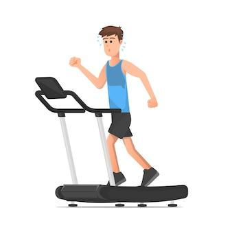若い男が汗をかくまでトレッドミルで走る
