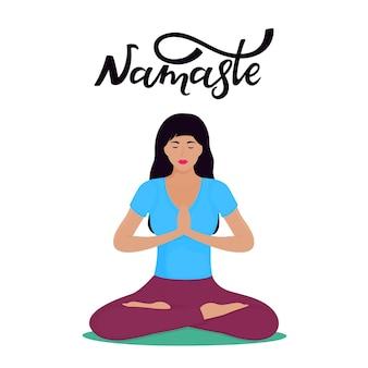 긴 검은 머리를 가진 젊은 백인 여성이 연꽃 위치에 앉아 있습니다. 요가. namaste 손으로 글자를 그립니다.