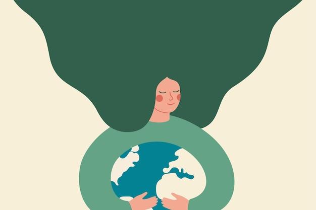 젊은 여성이 보살핌과 사랑으로 녹색 행성 지구를 포용합니다. 녹색 여성 활동가