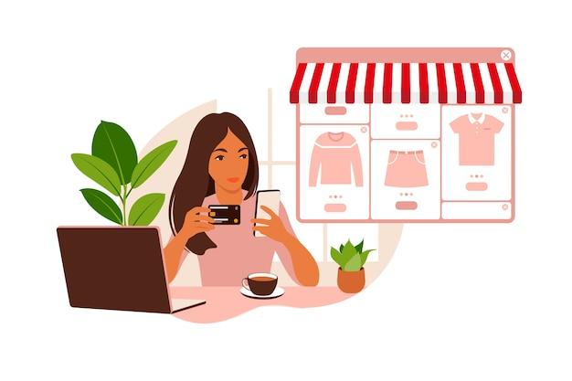젊은 여자가 노트북을 사용하여 온라인 쇼핑입니다. 인터넷을 통해 신용 카드로 구매를 지불하십시오. 온라인 결제 및 전자 구매, 쇼핑의 개념. 플랫.