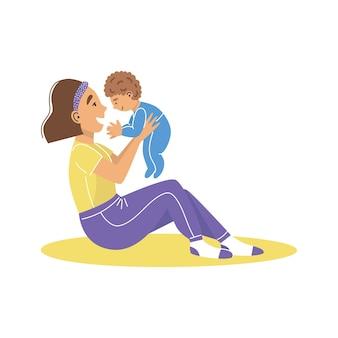 腕に男の子を抱いて若い女性の母親。ママは赤ちゃんを抱きしめます。赤ちゃんを持つ母親。
