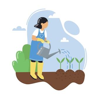 묘목에 물을 주는 젊은 여성 정원 가꾸기 야외 활동 정원에서 일하기
