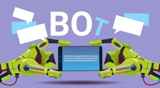 携帯スマートフォン、ウェブサイトやモバイルアプリケーションのロボット仮想アシスタンスを使用したチャットボットの手、a