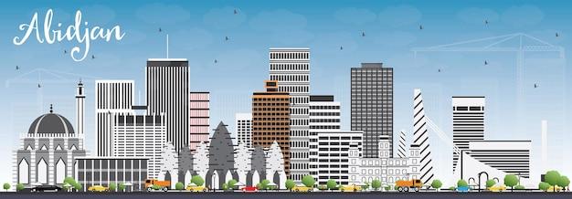 灰色の建物と青い空とアビジャンのスカイライン。ベクトルイラスト。近代建築とビジネス旅行と観光の概念。プレゼンテーションバナープラカードとwebサイトの画像。