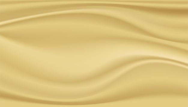 抽象的な背景きれいな豪華な布または金の生地のテクスチャ背景の波状の折り目。