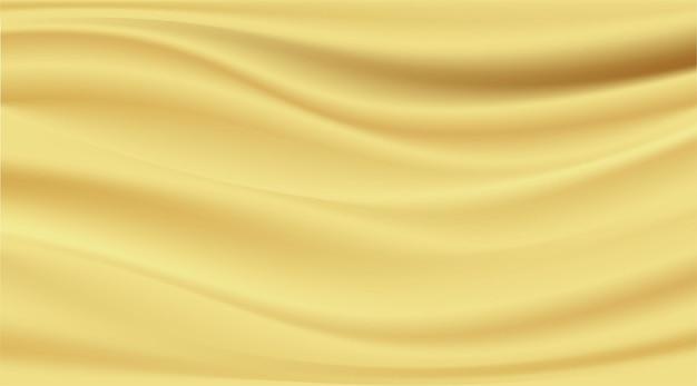 추상적 인 배경 깨끗한 고급 천 또는 골드 패브릭 질감 배경의 물결 모양의 주름.