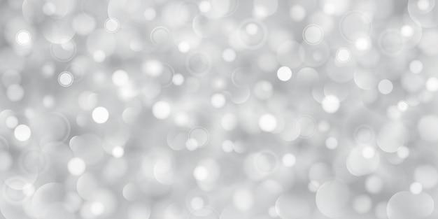 ボケ効果のある灰色の大小の半透明の円の抽象的な背景