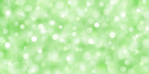 ボケ効果のある緑色の大小の半透明の円の抽象的な背景
