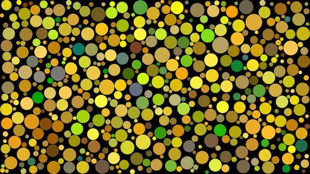 黒の背景に黄色の色合いでさまざまなサイズの円の抽象的な背景。