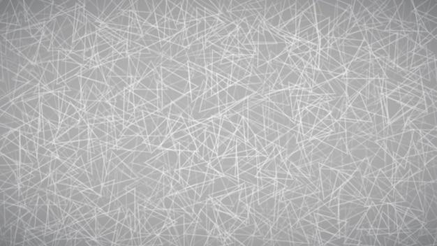 회색 색상으로 삼각형의 무작위로 배열된 윤곽선의 추상적인 배경.