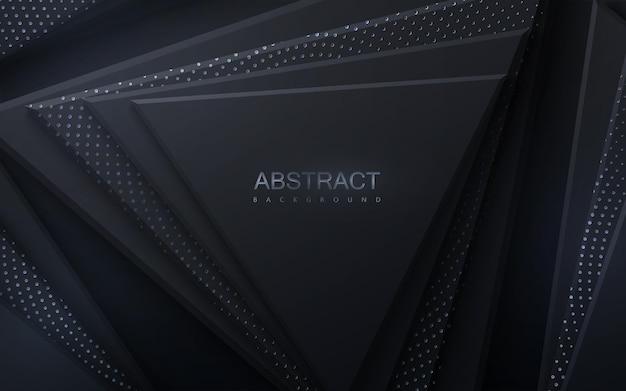 Абстрактный фон с черными геометрическими треугольными фигурами, текстурированными серебристыми мерцающими блестками