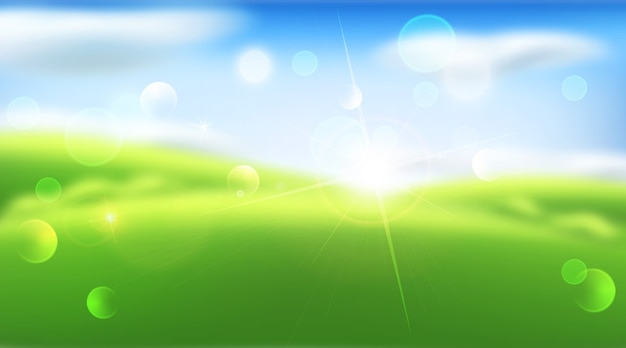 ぼやけた抽象的な背景。緑の草、空、雲、太陽。