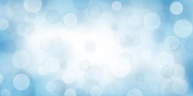 水色のボケ効果を持つ抽象的な背景