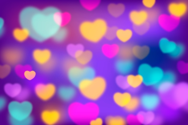 Abstract background with colorful bokeh hearts