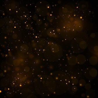 Abstract background with gold bokeh effect, dust particles.