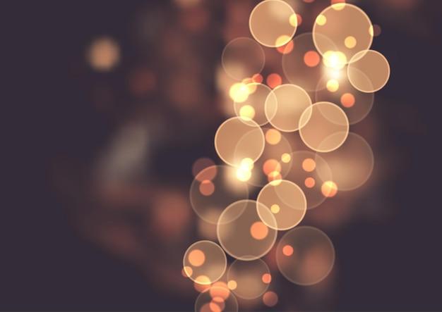 黄金のボケ ライトと抽象的な背景 無料ベクター