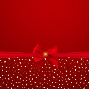 赤い弓とリボンと抽象的な背景。