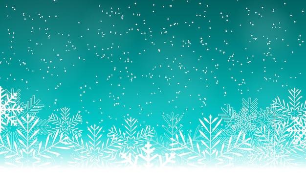 雪と雪片と抽象的な美しさのクリスマスと新年の背景