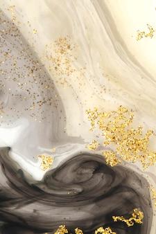 抽象的な黒の水彩画とゴールドのキラキラ背景