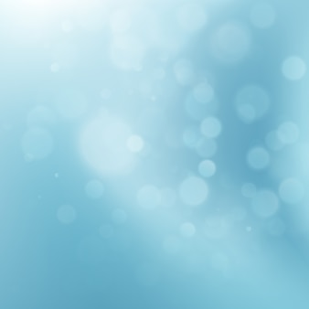 Abstract blue circular bokeh background.