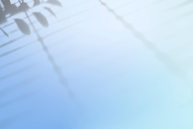 葉の影と抽象的な青いグラデーションの背景ベクトル