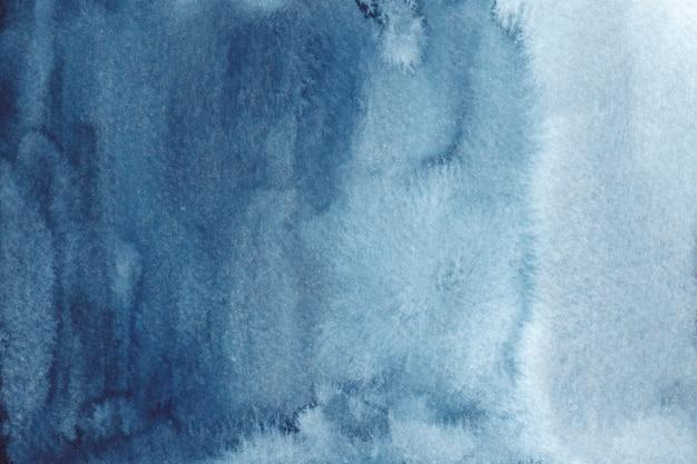 抽象的な青い水彩背景。手描き水彩テクスチャ
