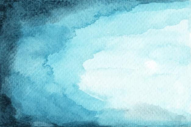 抽象的な青い水彩画の背景。異なる密度の層。