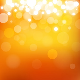 Abstract blur bokeh and lens flare on summer orange