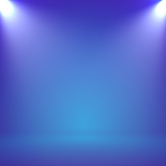 Abstract blurry smooth blue color background studio with spotlight for your presentation