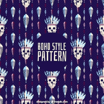 Abstract boho pattern with skulls and feathers