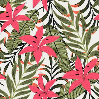 Abstract bright seamless pattern with colorful tropical leaves and flowers on light