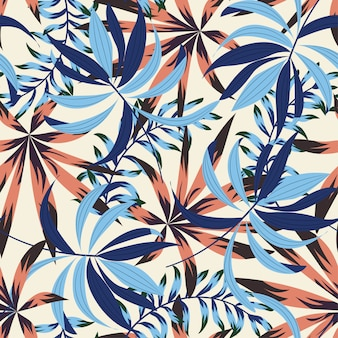 Abstract bright seamless pattern with colorful tropical leaves and flowers
