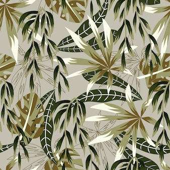 Abstract bright seamless pattern with colorful tropical leaves and plants on beige