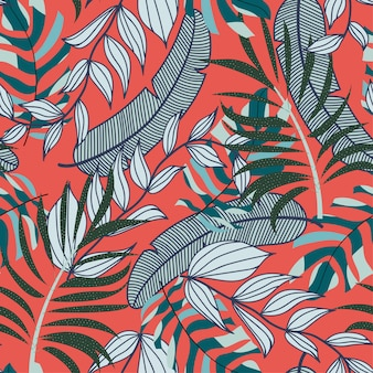 Abstract bright seamless pattern with colorful tropical leaves and plants on red