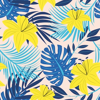 Abstract bright seamless pattern with colorful tropical leaves and plants