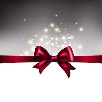 弓と抽象的なクリスマスの青い光の背景