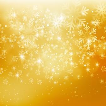 抽象的なクリスマスの雪の背景。金色。