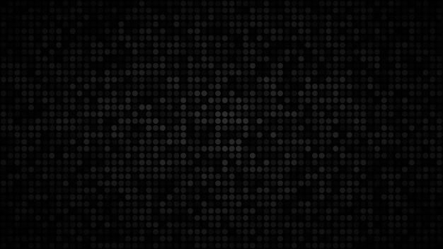 Абстрактный темный фон из маленьких кругов в оттенках черного и серого цветов.