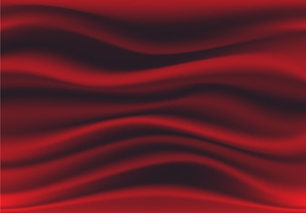 Abstract deep red fabric satin wave luxury background.