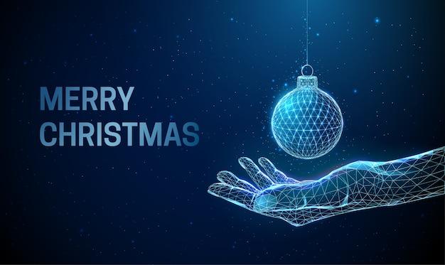 クリスマスボールで手を与える抽象的な。低ポリスタイル。