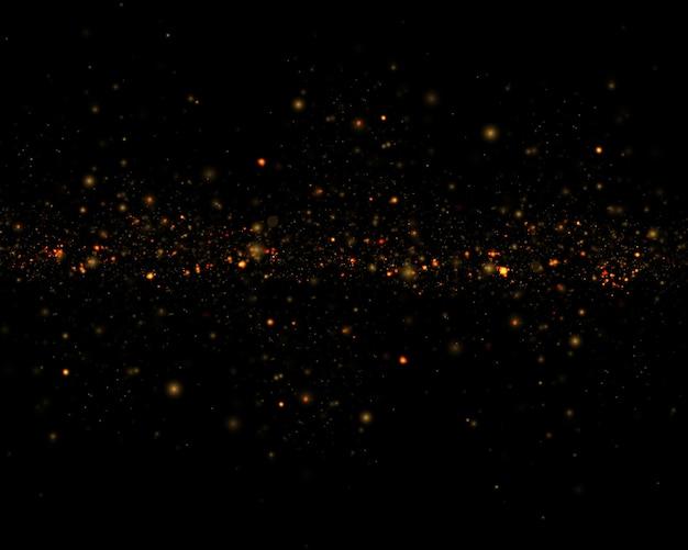 抽象的なキラキラが点滅する星と火花の焦点をぼかす。