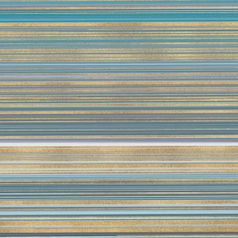 抽象的なキラキラ液体水彩テクスチャ。青と金色の水墨画パターン。