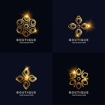 Abstract golden flower or boutique ornament logo set collection.