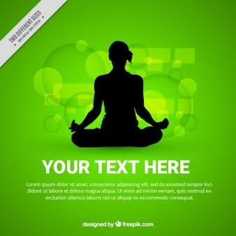女性のシルエットが瞑想と抽象的な緑の背景