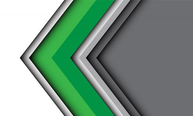 灰色のモダンな未来的な技術の背景を持つ抽象的な緑白い矢印の方向。