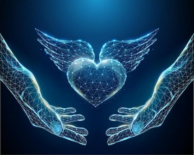 翼を持つ青いハートを保持する抽象的な手
