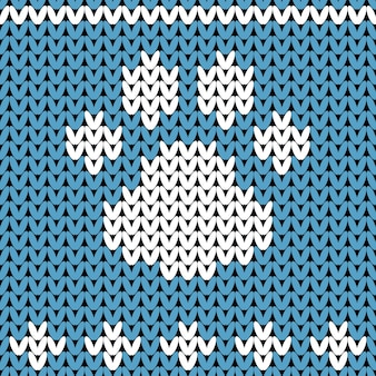 Abstract knitted dog paw pattern. winer knit texture for new year, merry christmas wrapping paper.