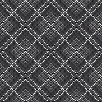 抽象的なニットパターン。灰色の色合いでシームレスな背景をベクトルします。ニットウールセーターのデザイン。